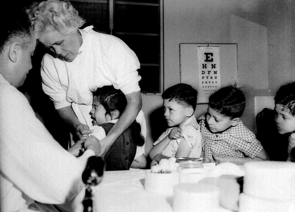 First- and second-graders at St. Vibiana's school are among the first to be inoculated for polio with the Salk vaccine in Los Angeles in 1955.