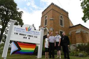 Bishop Tony Green, right, with Father Vic DeSantis and his wife, Mary, left, and Deacon Grace Ferris, center right, stand outside the Eastern Parkway Methodist Church, where they are sharing worship space, on Thursday in Schenectady, N.Y. Bishop Green and his deacons are sharing worship space at the Methodist church and want the LGBTQ community to know they are welcome to worship with them. (Will Waldron/Times Union)