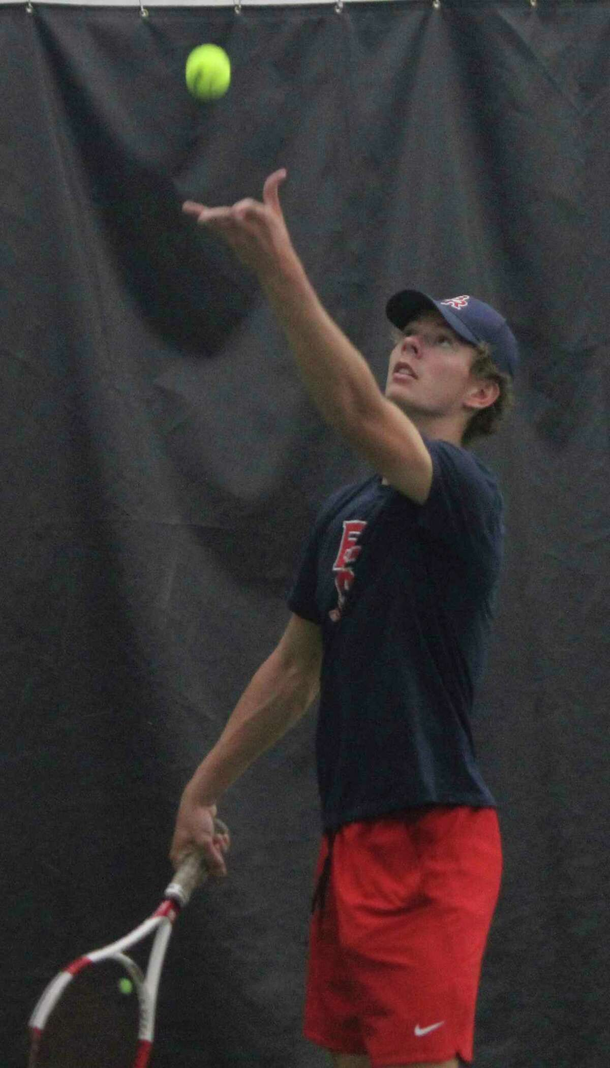 Big Rapids' Owen Bomay gets set to serve at No. 1 doubles for Big Rapids on Thursday. (Pioneer photo/John Raffel)