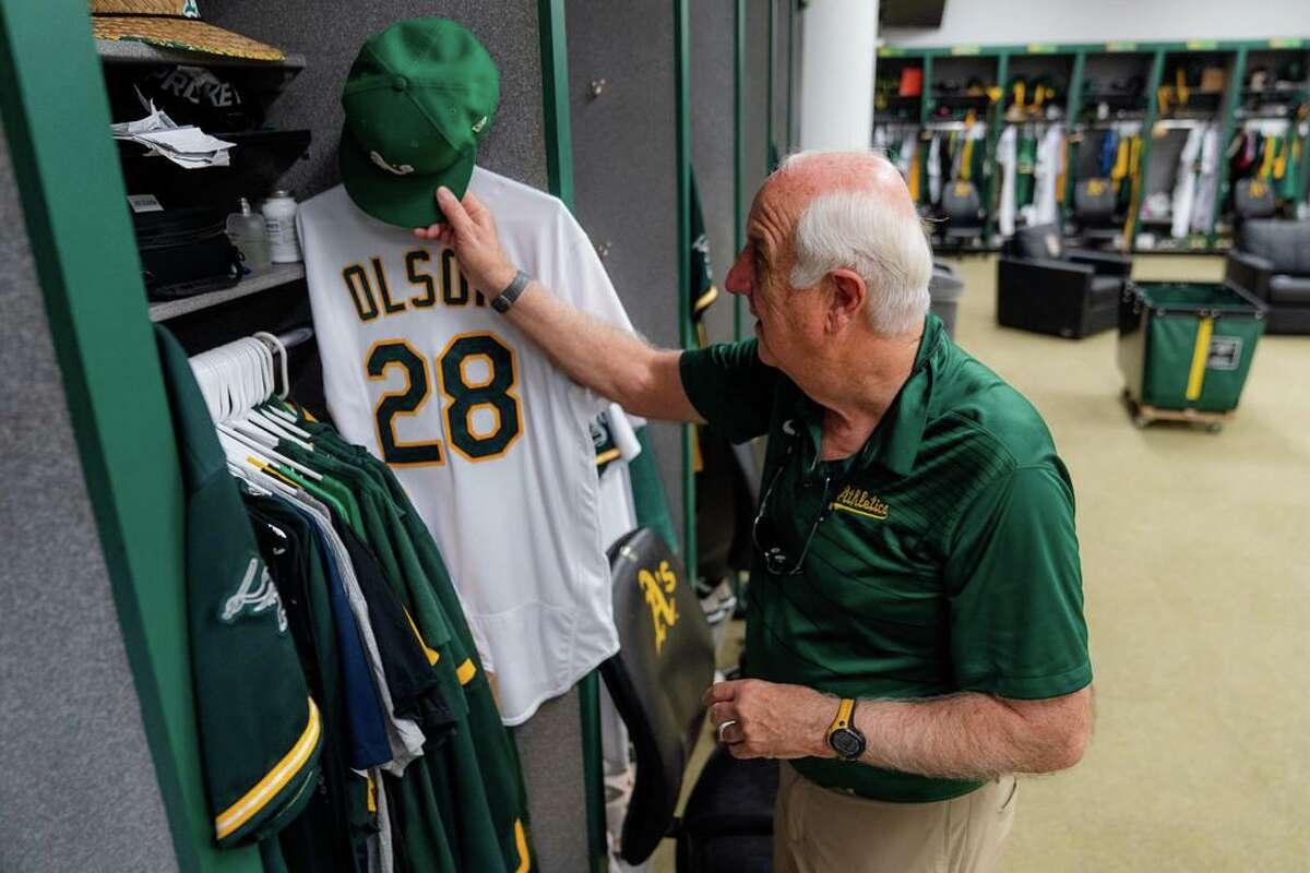 Steve Vucinich puts a hat into the locker of Oakland Athletics' first baseman Matt Olson at RingCentral Coliseum in Oakland, Calif., on Wednesday, September 22, 2021.
