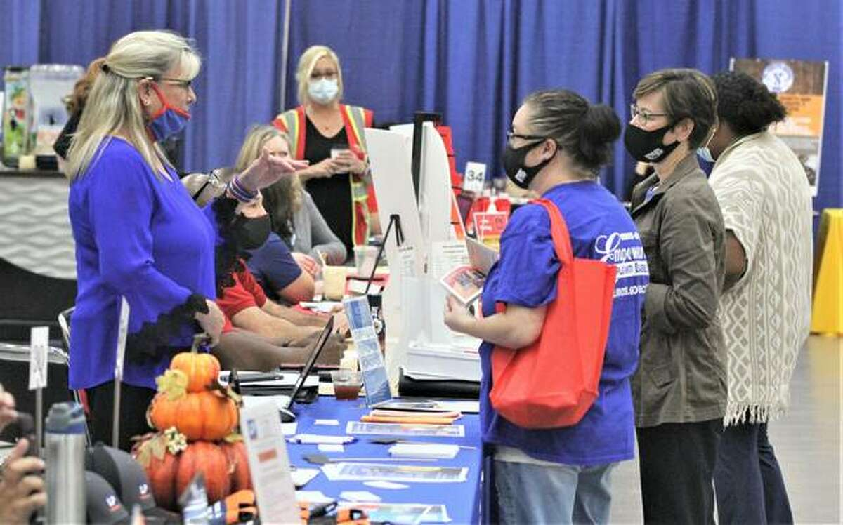 Employer representatives talk to potential workers at the annual Jobs Plus Regional Job Fair, held Wednesday at the Gateway Center in Collinsville. Fewer job-seekers than previous years attended this year's fair.