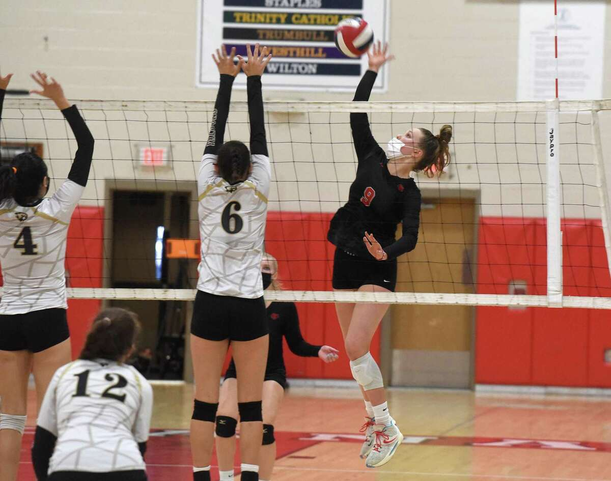 New Canaan's Lily Stevens (9) takes a shot while Joel Barlow's Sofia Araman (4) and Katherine Czerkawski (6) attempt to block during a girls voleyball match in New Canaan on Friday, Sept. 17, 2021.