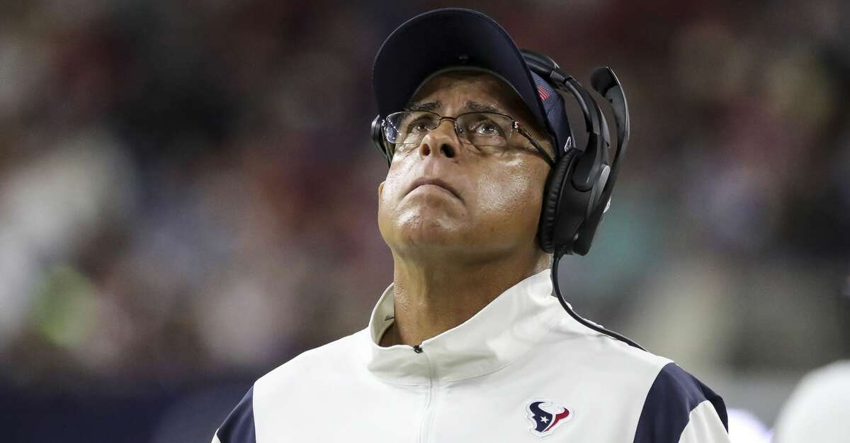 Houston Texans head coach David Culley watches a replay during the second quarter of an NFL football game at NRG Stadium, Thursday, September 23, 2021, in Houston.