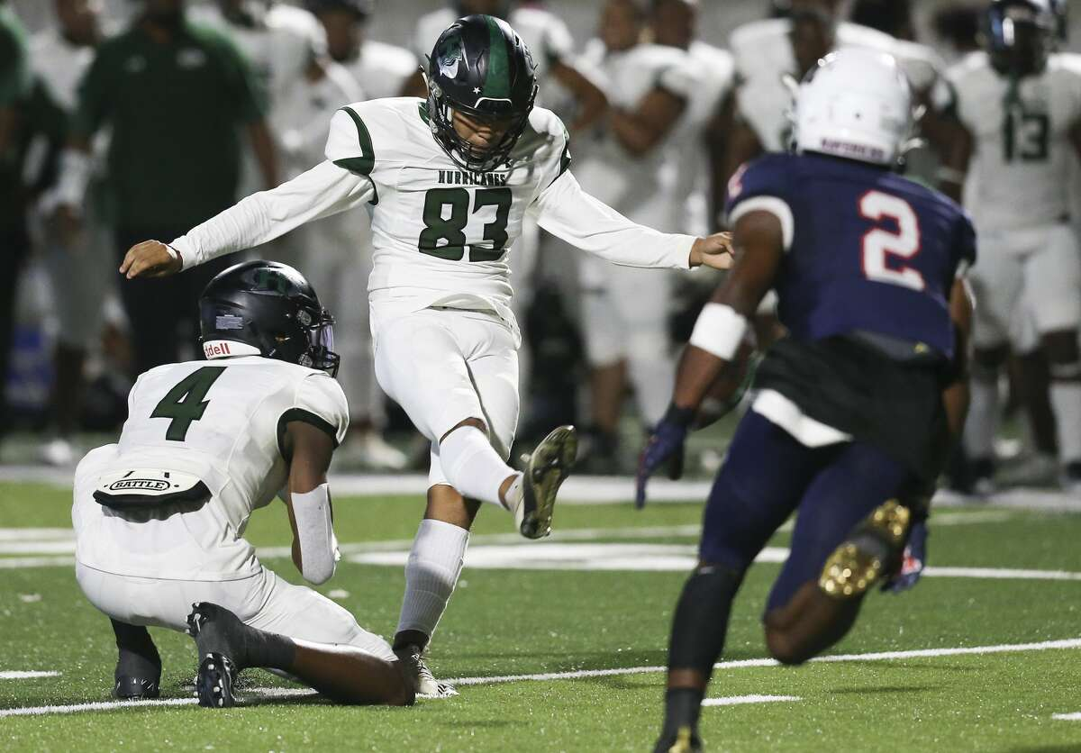 Hightower Hurricanes place kicker Armando Ventura #83 kicks a 35 yard field goal against the Manvel Mavericks in a district 10-5A Division I high school football game in the fist half on September 23, 2021 at Freedom Field in Rosharon, Texas .