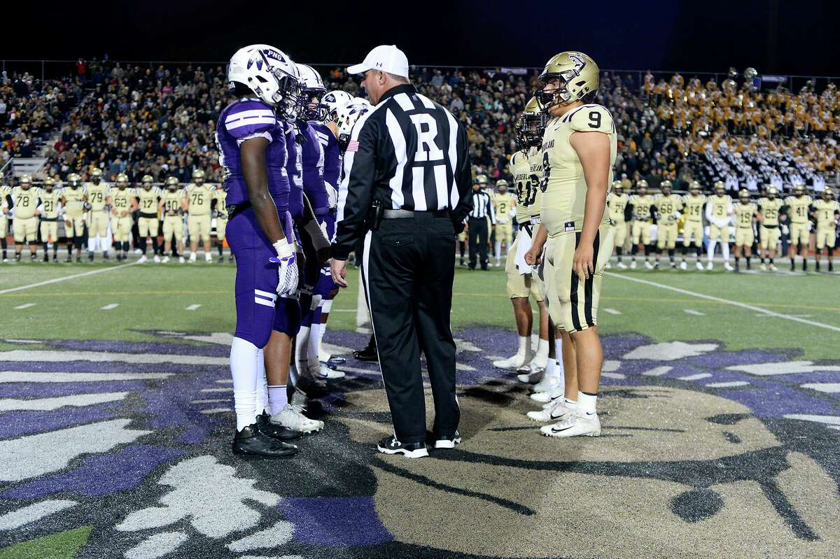 Port Neches-Groves and Nederland captains meet before the start of the Mid-County Madness game at Indian Stadium on Friday night. Photo taken Friday 11/9/18 Ryan Pelham/The Enterprise