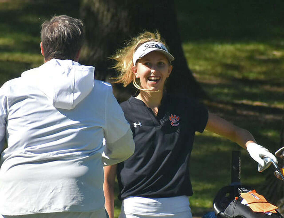 Edwardsville's Grace Daech smiles at coach Libby Koonce after putting her second shot on No. 9 less than a foot from the hole. She finished the hole with a tap-in eagle.