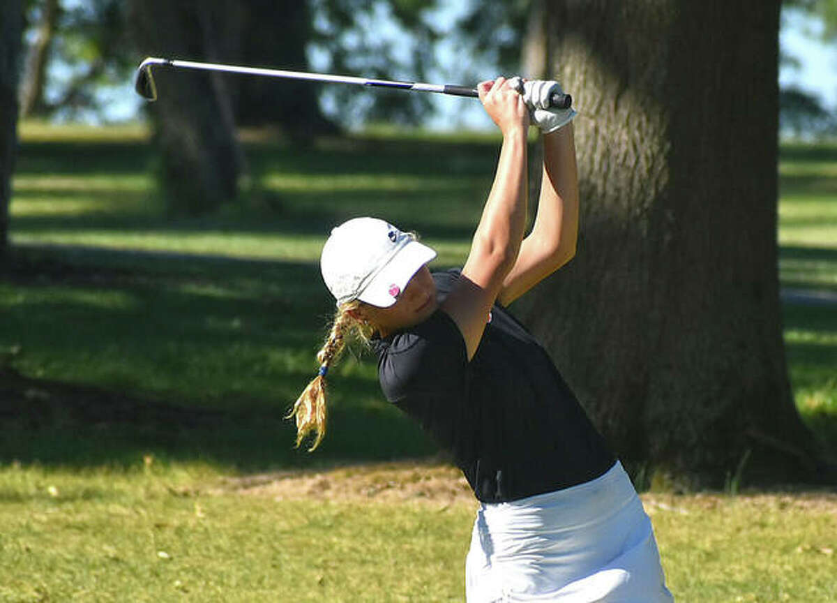 Edwardsville's Morgan Landry follows through on her third shot on No. 9 at Oak Brook Golf Club on Thursday during the Dick Gerber Invitational.