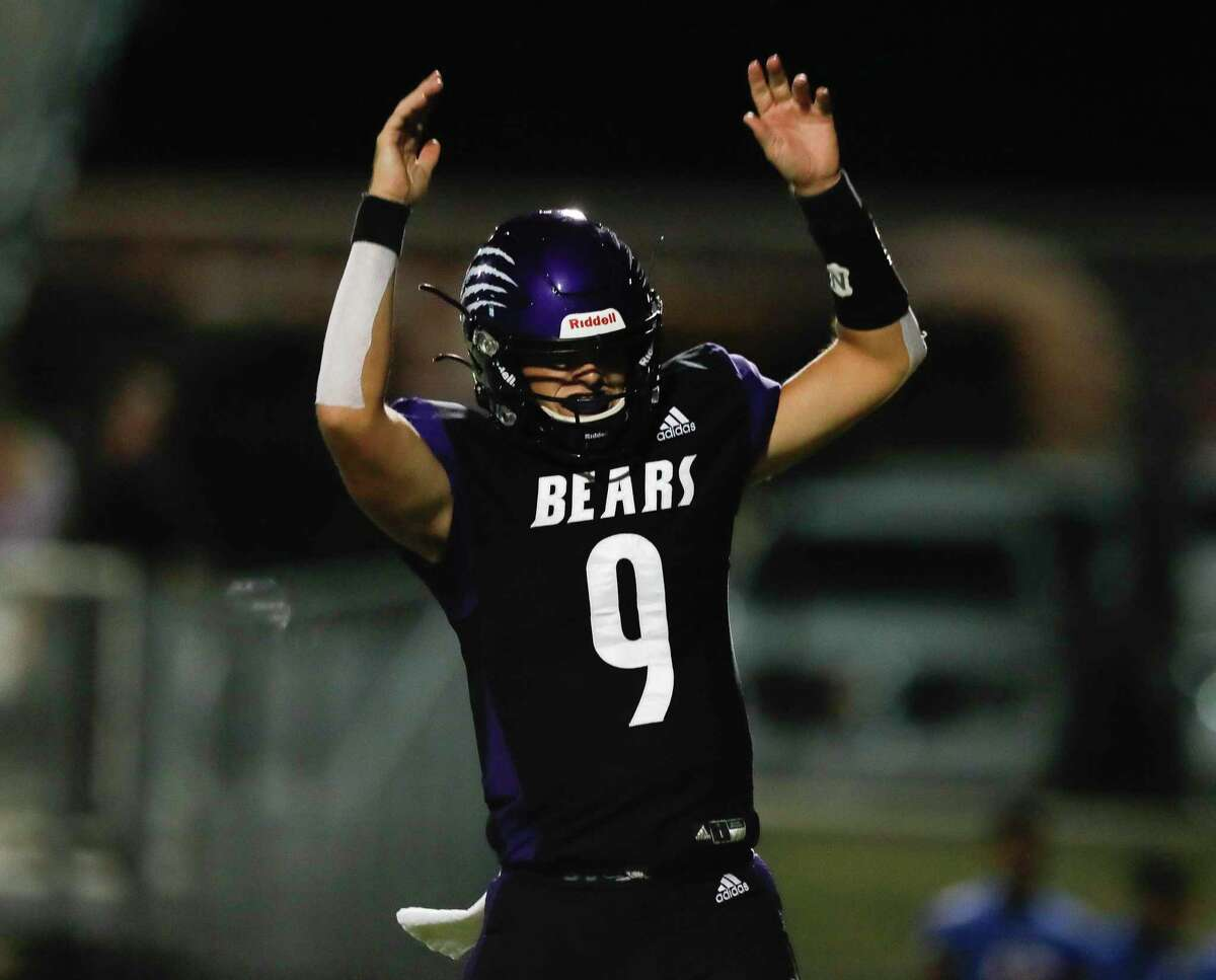 Montgomery quarterback Brock Bolfing (9) reacts after a 1-yard touchdown by running back Traven Lewis-Johnson during the third quarter of a non-district high school football game, Thursday, Sept. 23, 2021, in Montgomery.