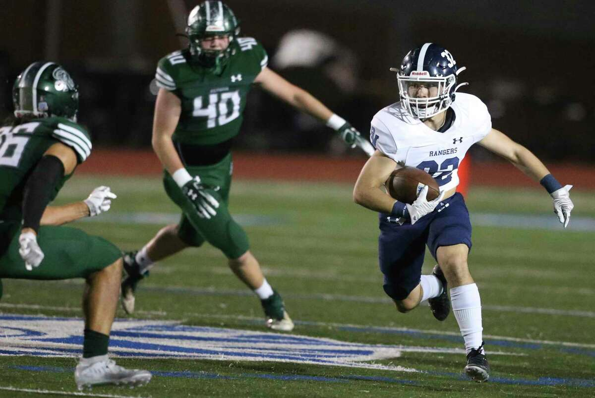 Travis McCracken, right, rushed for 86 yards and three touchdowns in Smithson Valley's win over New Braunfels.