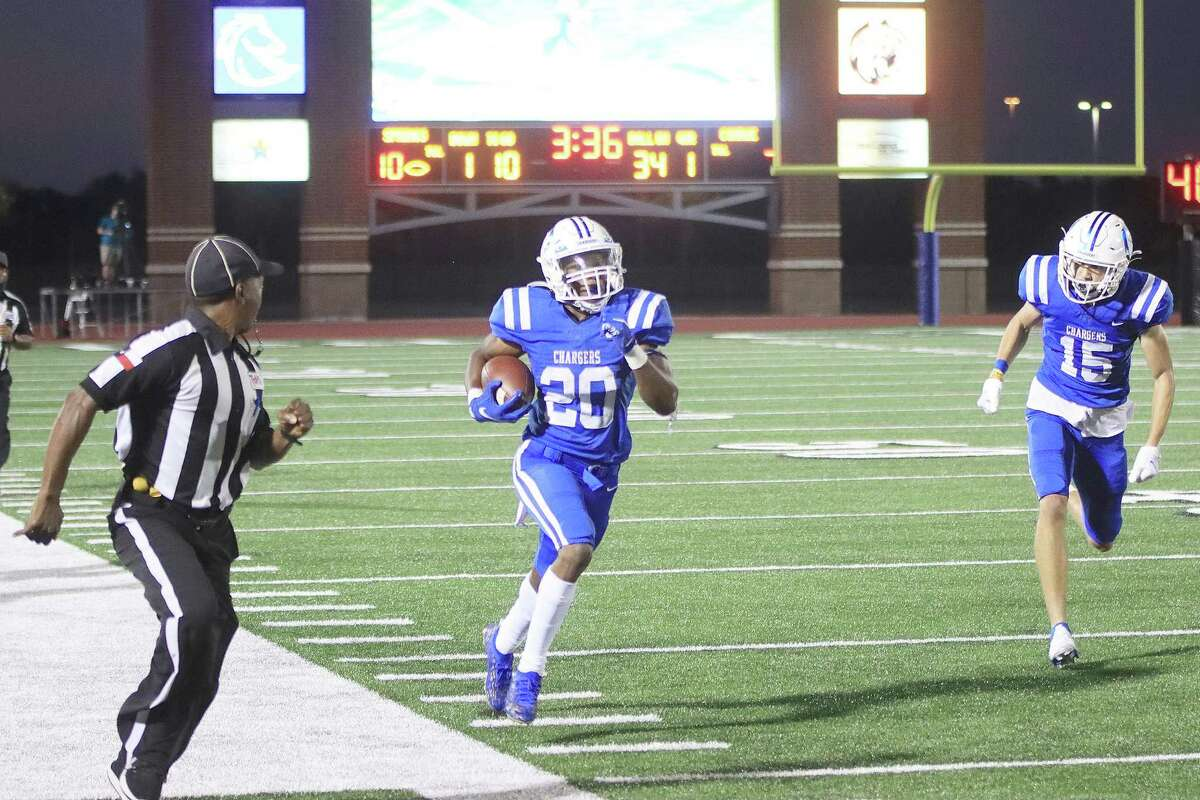 Xai-Shaun Edwards of Clear Springs races down the sidelines for a touchdown Thursday night against Conroe in the Chargers' 64-27 win.