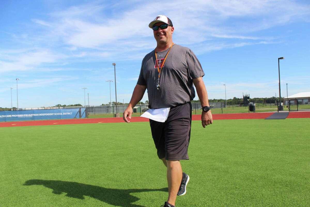 Hargrave coach Mike McEachern walks onto Falcons Stadium to start practicet. McEachern won his 100th game of his coaching career last week.