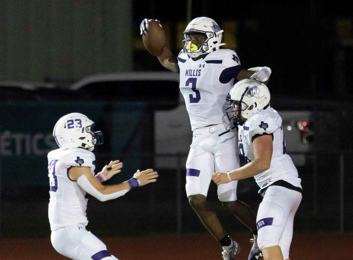 Willis defensive back Tallas Harrison (3) celebrates after he scores a touchdown after intercepting a pass during the third quarter of a non-district football game against Klein Collins at Klein Memorial Stadium, Thursday, Sept. 23, 2021, in Spring.
