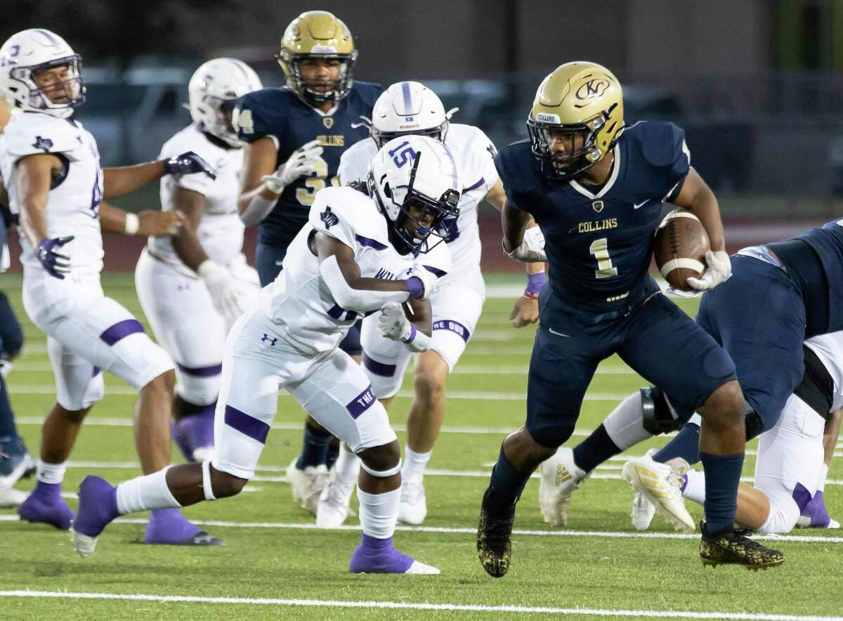 Klein Collins running back Jeremiah Hasan-Hackney (1) runs the ball while under pressure from Willis defensive back Jayden Marshman (15) during the first quarter of a non-district football game at Klein Memorial Stadium, Thursday, Sept. 23, 2021, in Spring.