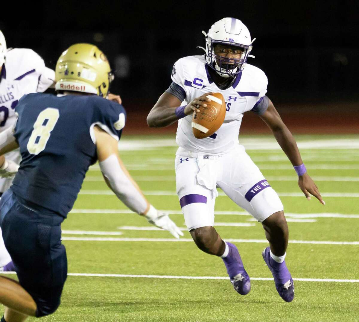 Willis quarterback Derek Lagway (2) looks for an opening to run the ball passed Klein Collins Reagan Schluter (8) during the third quarter of a non-district football game at Klein Memorial Stadium, Thursday, Sept. 23, 2021, in Spring.