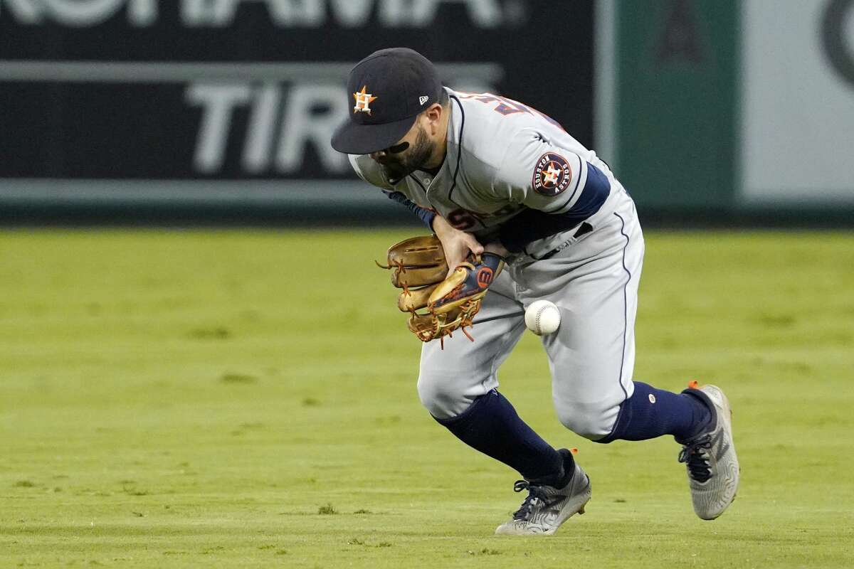 Houston Astros second baseman Jose Altuve bobbles a ball hit by Los Angeles Angels' Jose Rojas during the sixth inning of a baseball game Thursday, Sept. 23, 2021, in Anaheim, Calif. Mayfield was safe at first on the play and Altuve was charged with an error. (AP Photo/Mark J. Terrill)