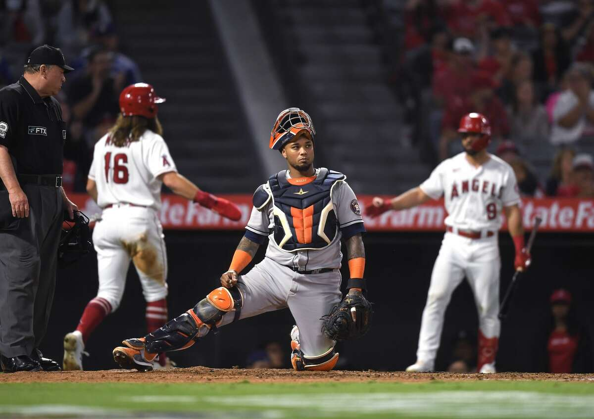 ANAHEIM, CA - SEPTEMBER 23: Martin Maldonado #15 of the Houston Astros reacts after Brandon Marsh #16 of the Los Angeles Angels scores a run during the fourth inning on a sacrifice fly by Jared Walsh #20 of the Los Angeles Angels at Angel Stadium of Anaheim on September 23, 2021 in Anaheim, California. (Photo by Kevork Djansezian/Getty Images)