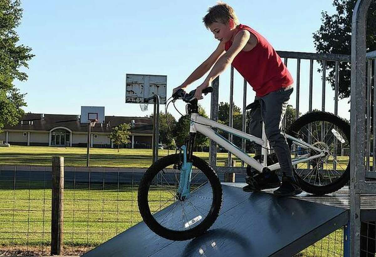 Jaxon Brogdon of Jacksonville enjoys a cool fall day Thursday as he prepares to ride his bicycle down a ramp at Community Park.
