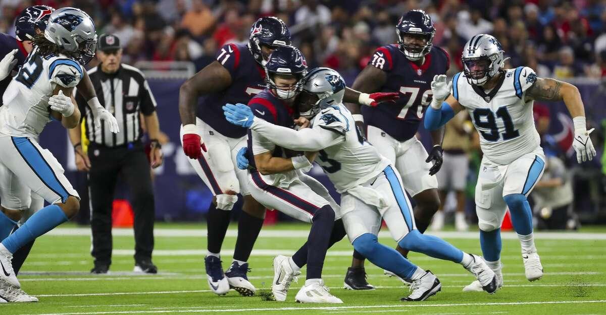 Houston Texans quarterback Davis Mills (10) is sacked by Carolina Panthers linebacker Haason Reddick (43) during the fourth quarter of an NFL football game Thursday, Sept. 23, 2021, in Houston.