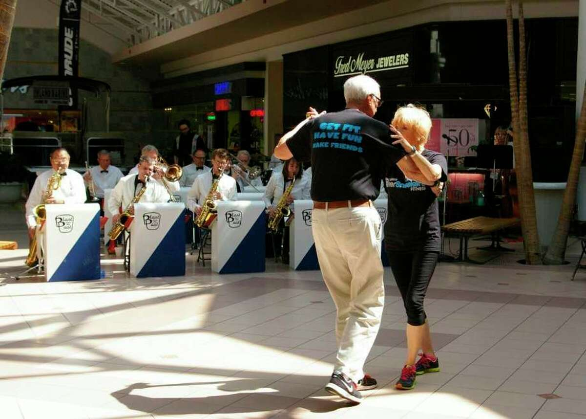 A couple dances during a prior performance by Blast From the Past Concert. (File photo/Midland Daily News)