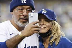 LOS ANGELES, CALIFORNIA - AUGUST 31: Comedian Jo Koy (L) and Comedian/actress Chelsea Handler (R) takes a selfie prior to a game between the Los Angeles Dodgers and the Atlanta Braves at Dodger Stadium on August 31, 2021 in Los Angeles, California. (Photo by Michael Owens/Getty Images)