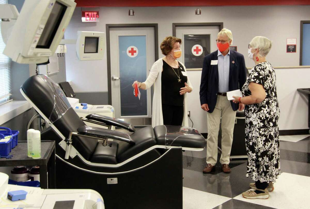 Susan Rounds, right, gives a tour of the new blood donor center and other renovations to supporters Sue and Perter Carlson during a grand opening celebration of the chapter building in Greenwich, Conn., on Thursday September 23, 2021.