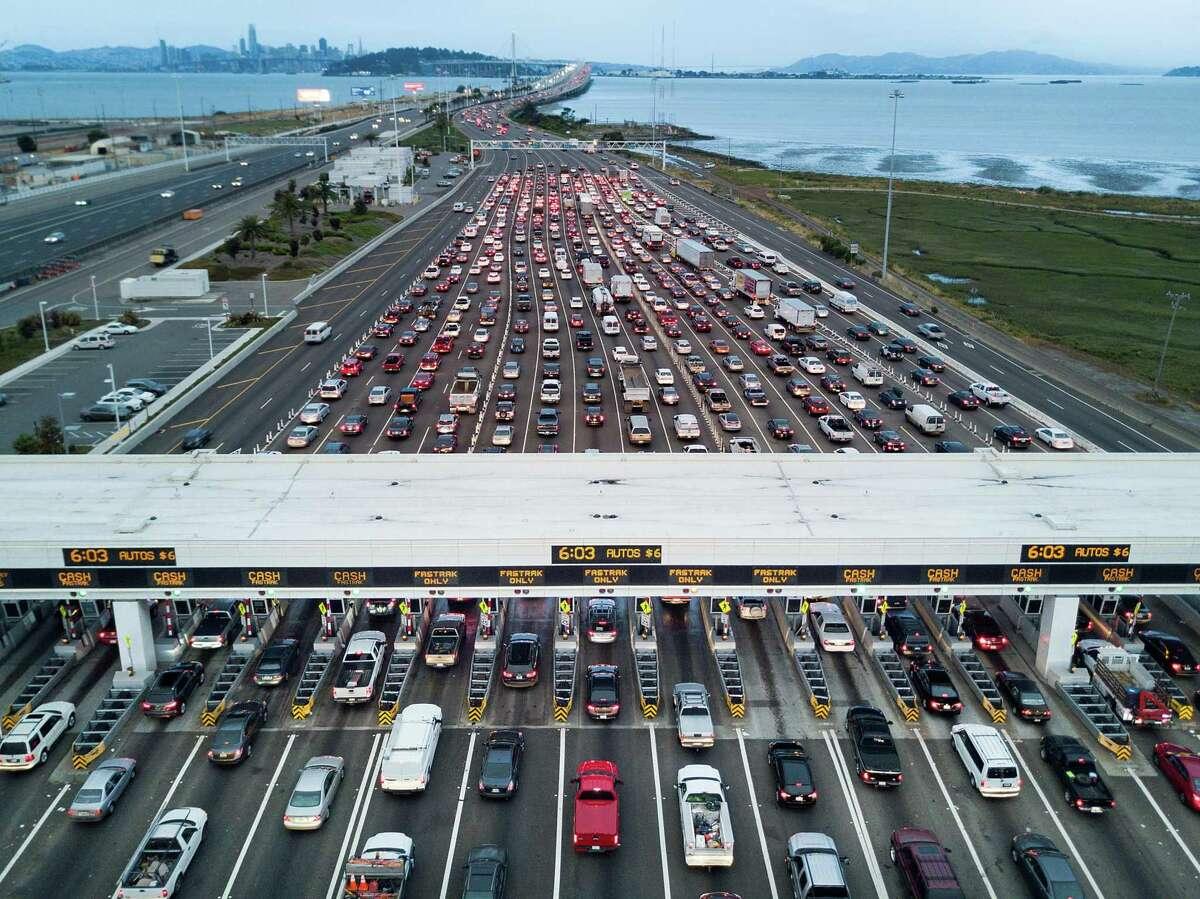 Traffic flows through the Bay Bridge toll plaza in Oakland.