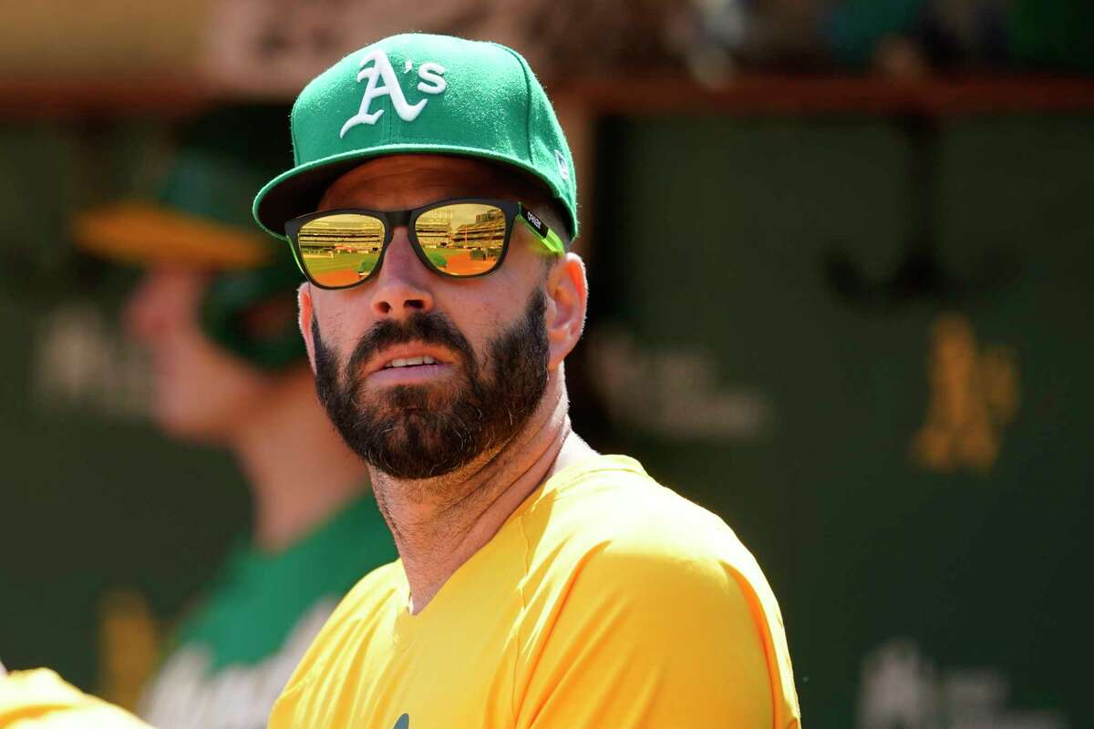 Injured Oakland Athletics pitcher Mike Fiers sits in the dugout during a game against the Chicago White Sox in Oakland, Calif., Sept. 9, 2021. (AP Photo/Jeff Chiu)