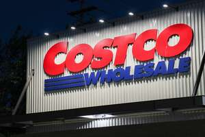 The Costco logo is seen on the exterior of a store in Seattle. (Photo by Toby Scott/SOPA Images/LightRocket via Getty Images)
