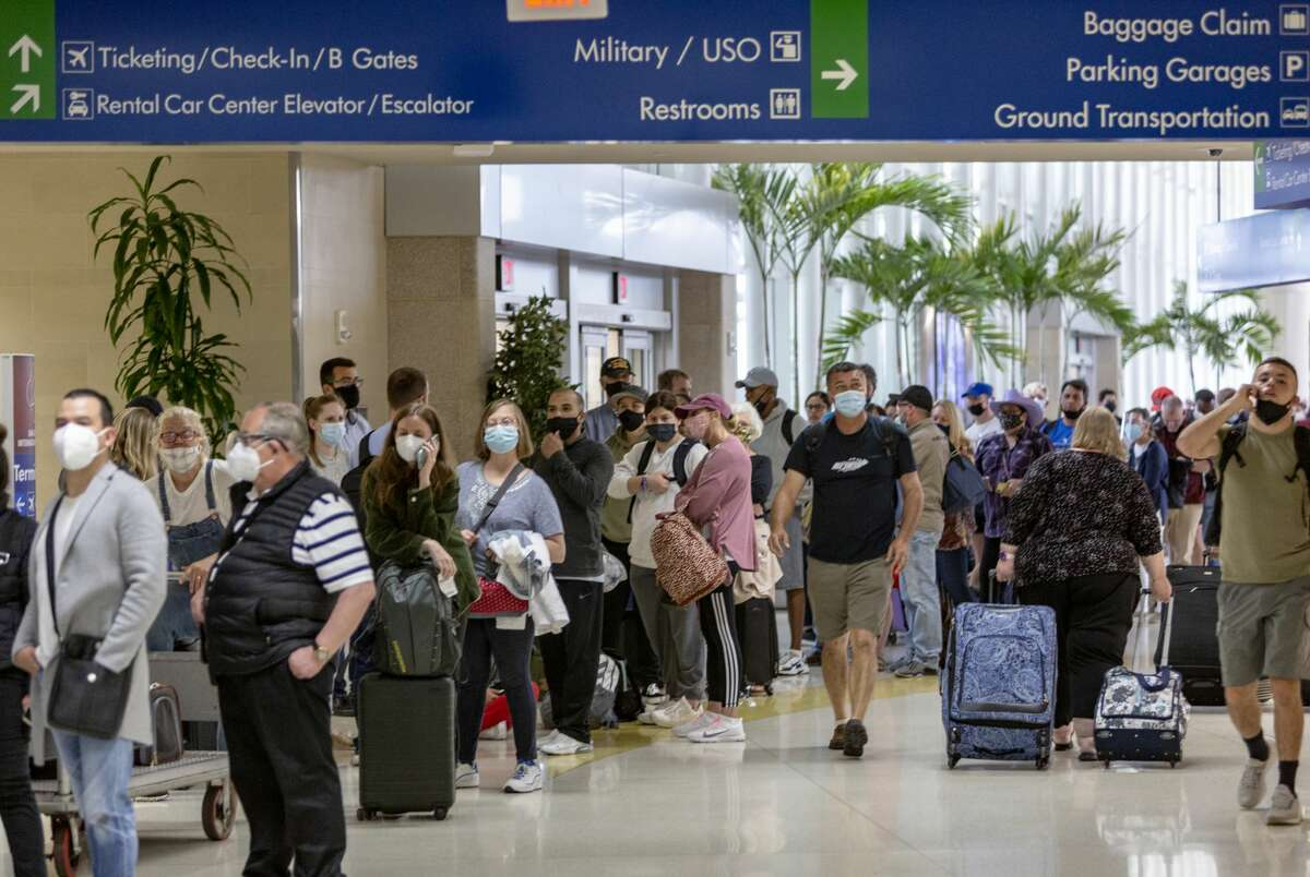 Passengers wait in line Thursday, April 15, 2021 in Terminal A of the San Antonio International Airport for TSA checkpoints to reopen.
