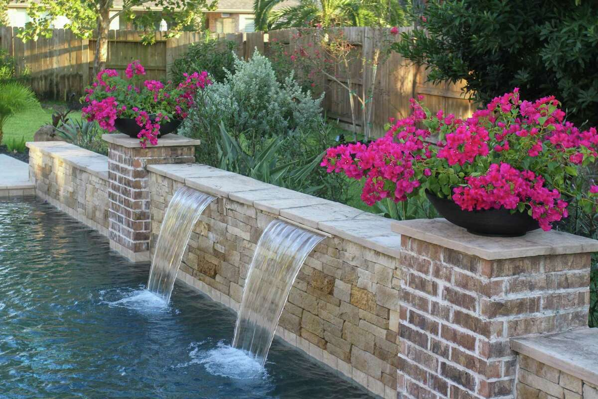 Shallow planters filled with bougainvillea bring spalshes of color to the backyard of area around the pool atbaThe monthly Eight Seats Garden Club garden party in Manvel on September 18, 2021.