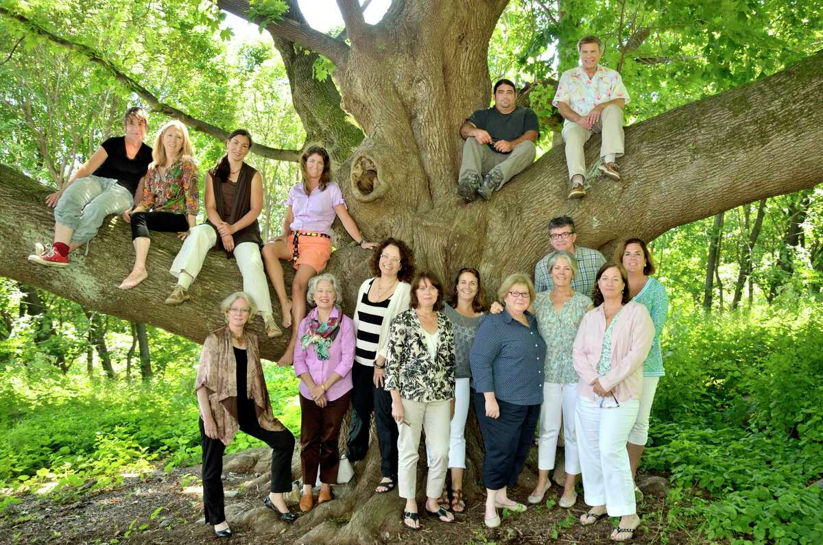 In 2014, members of the Ridgefield Guild of Artists recreated a photo taken in front of its Norway maple tree during the 1970s. A parking lot planned for the guild and its neighbors will leave the tree untouched.