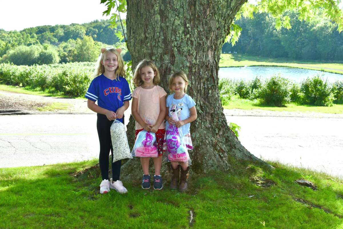 Children and their families went apple-picking Sept. 18 at March Farm in Bethlehem. Pictured are Fiona, Maeve, and Lucie King of Watertown.
