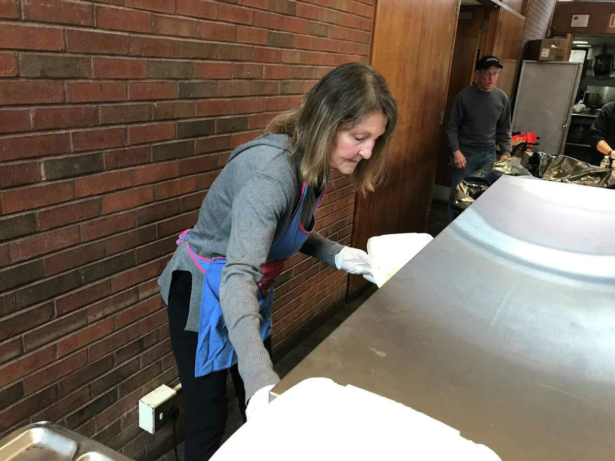 In this file photo, a Community Soup Kitchen volunteer prepares a meal in the Christ Church Parish House in 2019.