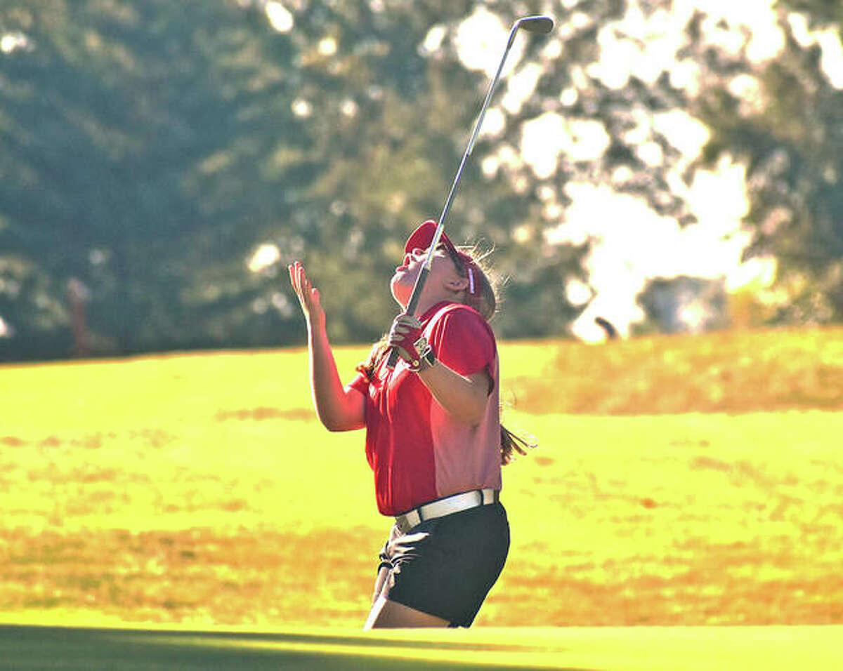 Alton freshman Addison Kenney reacts after her chip on hole No. 7 hits the pin and rolls away from the cup Thursday in the Gary Bair Invite at Oak Brook golf course in Edwardsville.