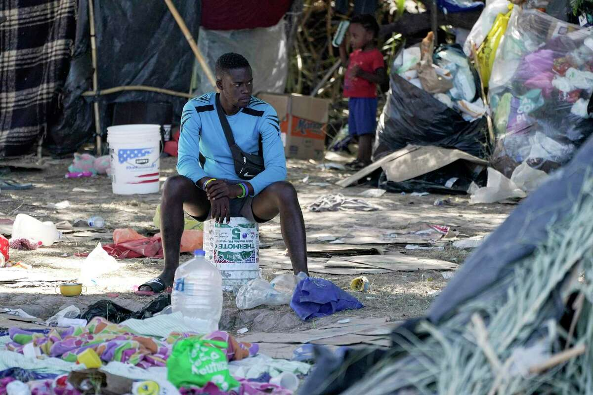 In this Sept. 23, 2021, file photo, a migrant man is seen in an encampment under the Del Rio International Bridge where migrants, many from Haiti, have been staying after crossing the Rio Grande, in Del Rio, Texas.