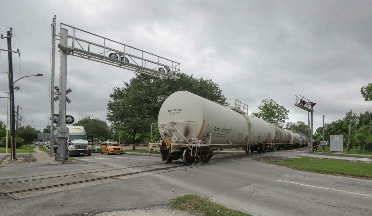 A train finally moves to open up traffic over tracks across Lockwood Avenue on May 18, 2021, in Houston.