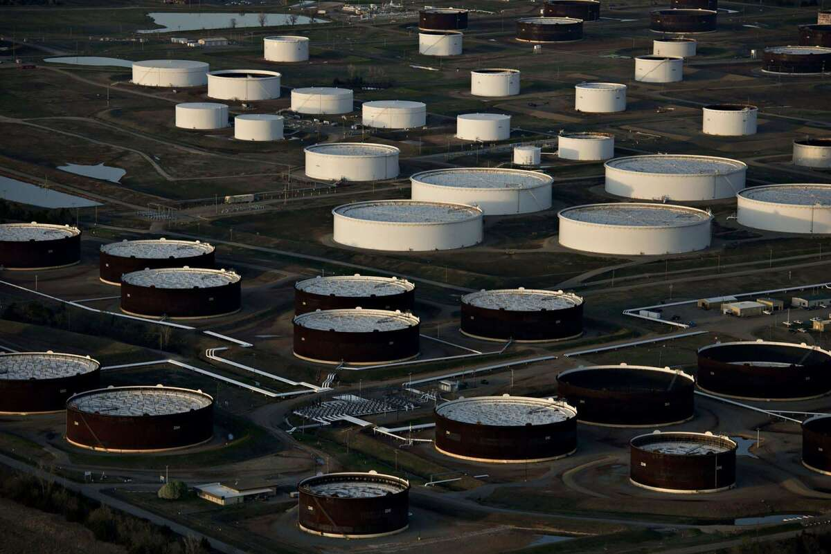Shortages of natural gas in Europe and Asia are boosting demand for oil, deepening what was already a sizable supply deficit in crude markets, the International Energy Agency said.