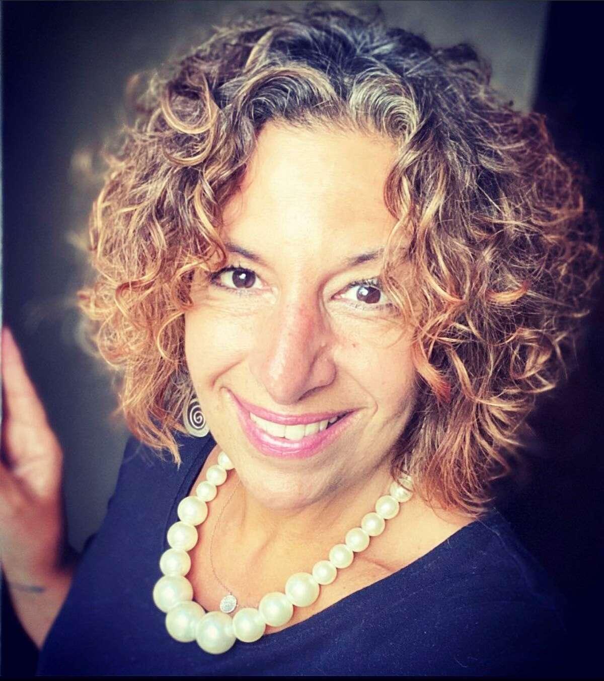 Victoria Iaccarino Burse works in Wesleyan University's development office in Middletown.