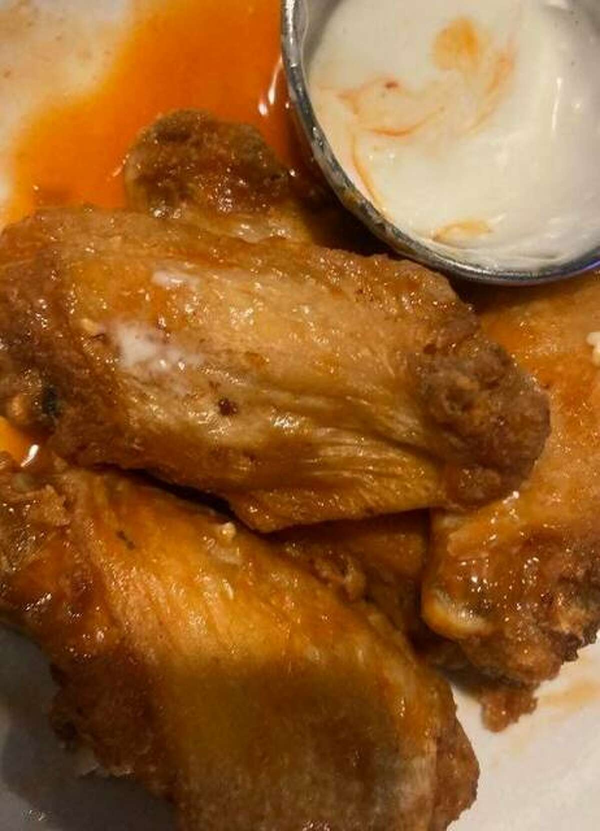 Bluff City Wings can be ordered with traditional buffalo sauce - with a kick but not so hot you break a sweat and your eyes water.