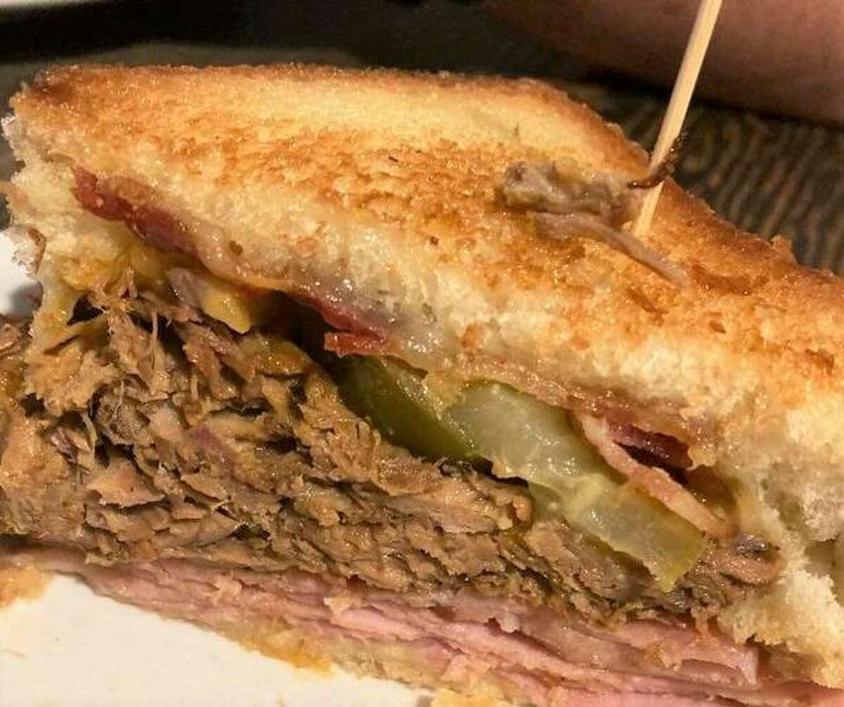 Bluff City's Three Little Pigs sandwich features pulled pork, applewood smoked bacon and grilled ham.