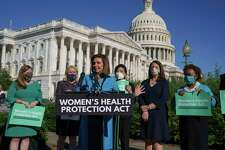 House Speaker Nancy Pelosi, D-Calif., joined from left by Rep. Lizzie Fletcher, D-Texas, Rep. Sylvia Garcia, D-Texas, Rep. Judy Chu, D-Calif., Rep. Diana DeGette, D-Colo., and Rep. Barbara Lee, D-Calif., holds a news conference just before a House vote on legislation aimed at guaranteeing a woman's right to an abortion, an effort by House Democrats to circumvent a new Texas law that has placed that access under threat, at the Capitol in Washington, Friday, Sept. 24, 2021. (AP Photo/J. Scott Applewhite)