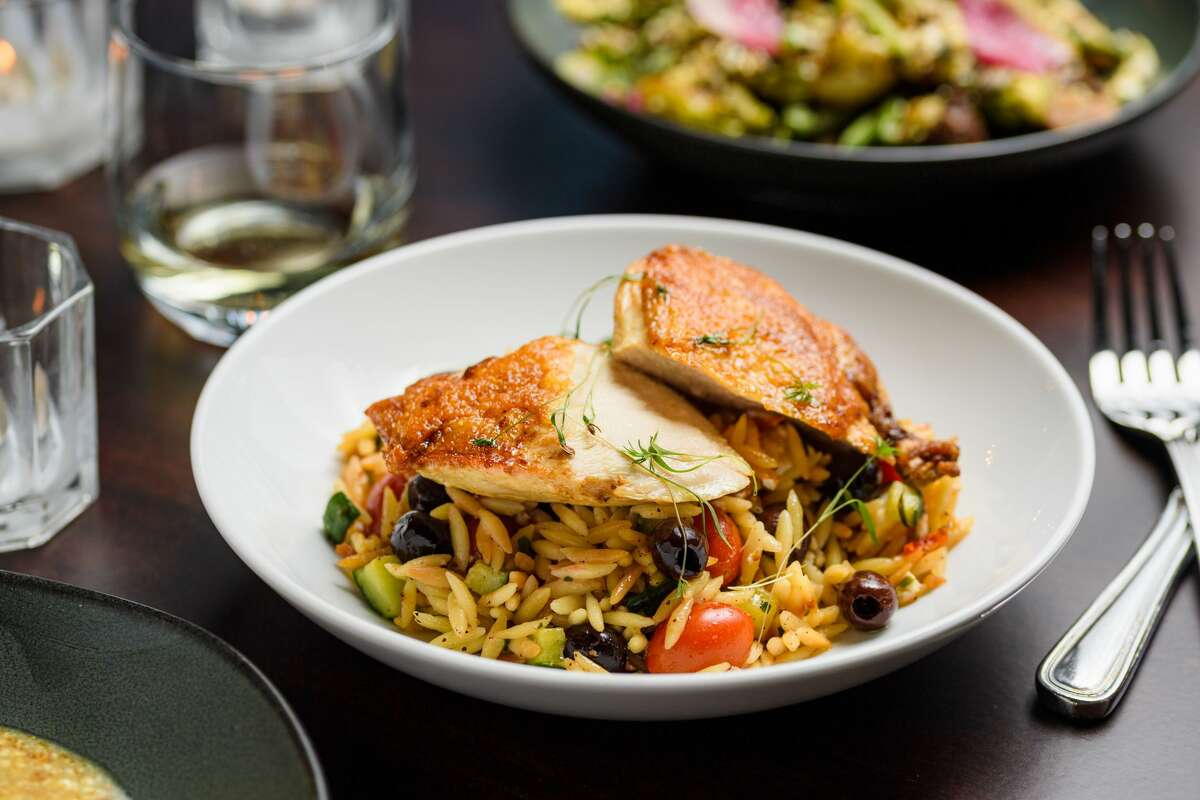 Pan-roasted chicken breast with toasted orzo salad at Seed 41 in Collinsville.