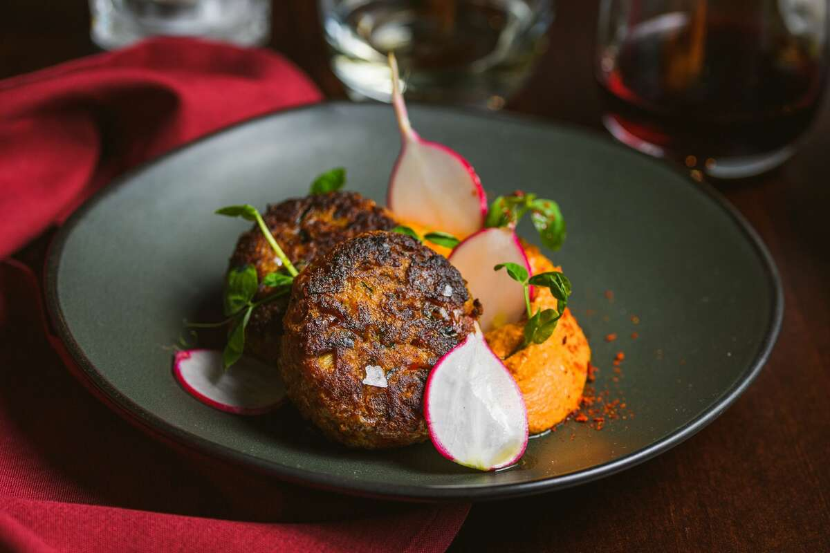 Crab cakes with sweet potato puree and Romesco sauce at Seed 41 in Collinsville.