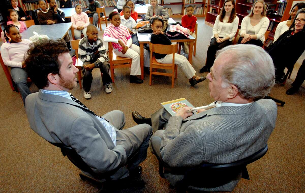Author William Kennedy, right, and his son Brendan, left, talk to students about writing stories on Tuesday, April 17, 2007, at Public School 20 in Albany, N.Y.