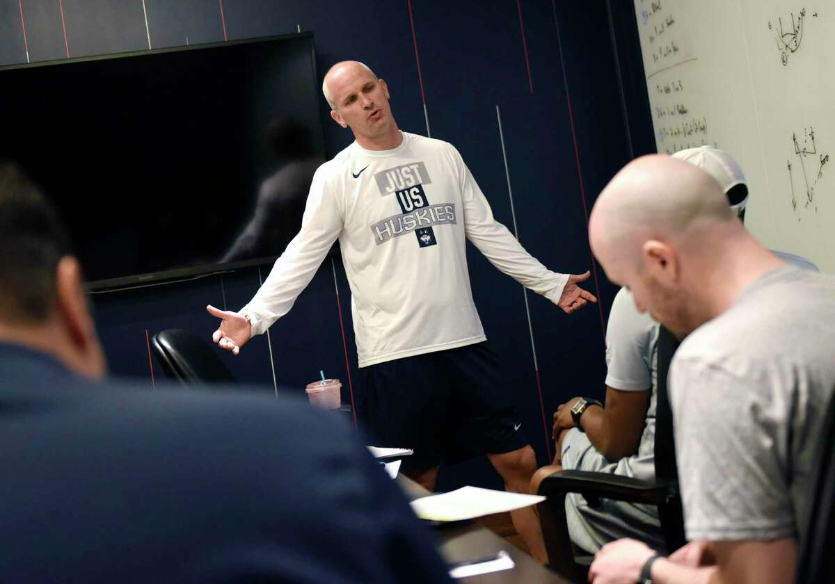 UConn men's basketball coach Dan Hurley meets with assistant coaches before practice at the Werth Family UConn Basketball Champions Center in Storrs June 9.