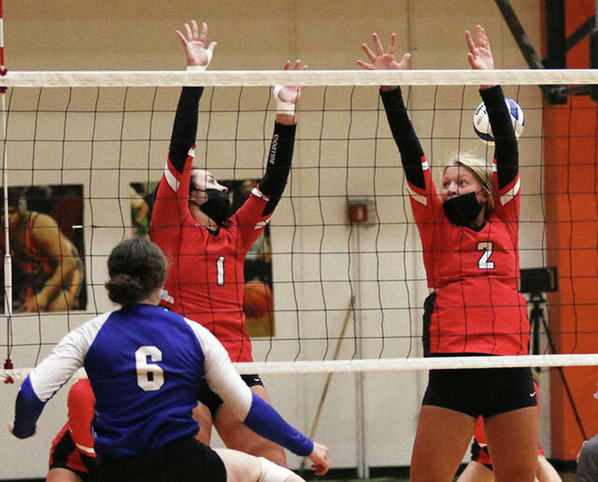 Freeburg's Lindsey Muskopf (6) hits past the double block from Staunton's Savannah Billings and Danielle Russell (2) during a Sept. 3 match at the Edwardsville Tourney. On Thursday, Staunton picked up a three-set SCC victory at Pana.