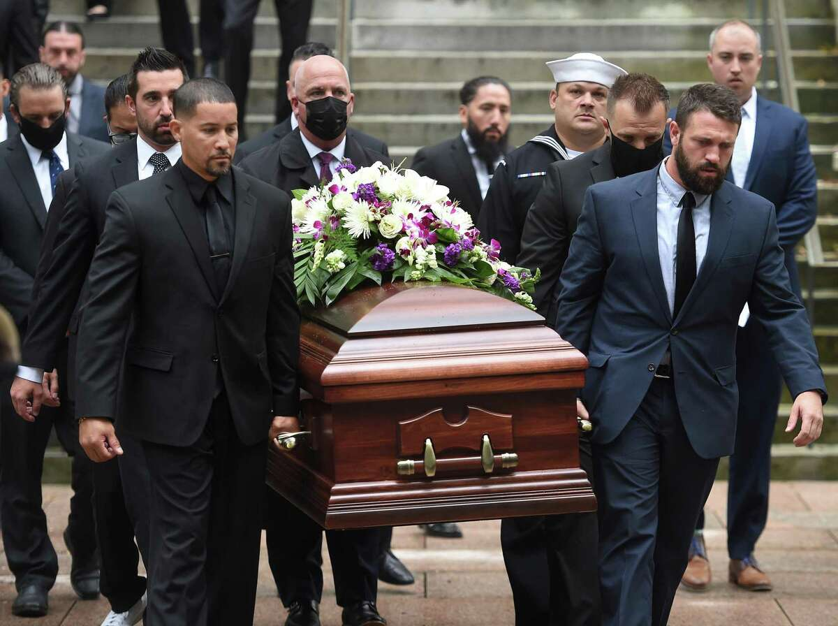 Pallbearers carry the casket of New Haven police Officer Joshua Castellano out of St. Mary's Church in New Haven Sept. 24, 2021.