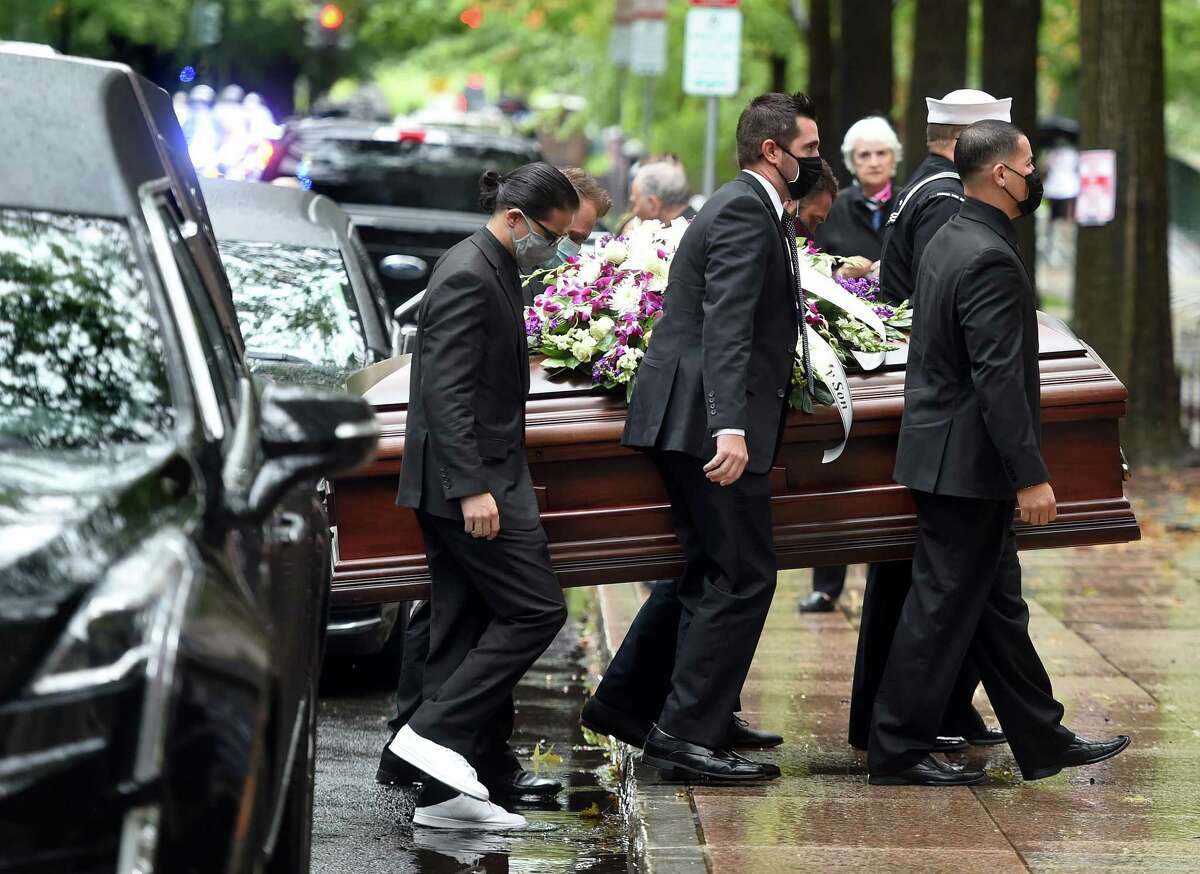 Pallbearers carry the casket of New Haven police Officer Joshua Castellano into St. Mary's Church in New Haven Sept. 24, 2021.