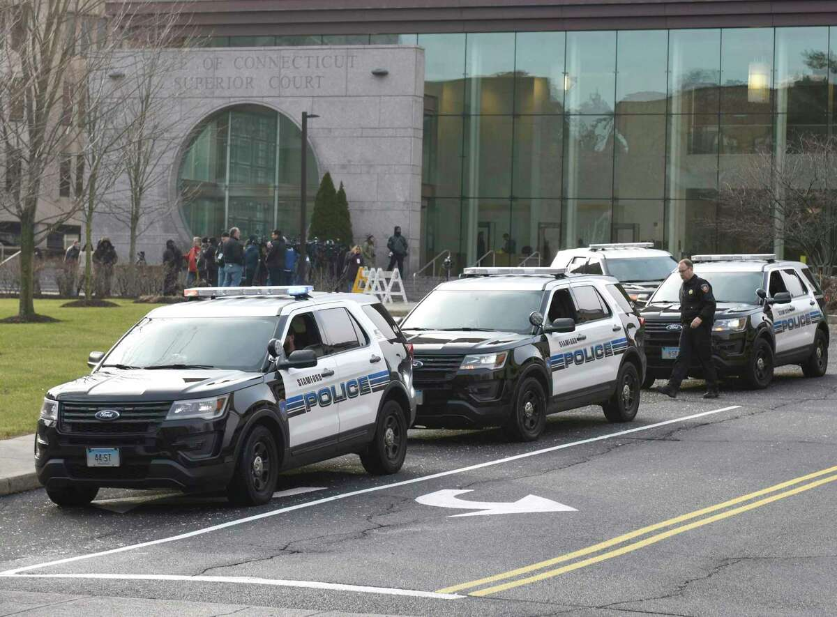 Police cars are gathered outside Connecticut Superior Court in Stamford last year.