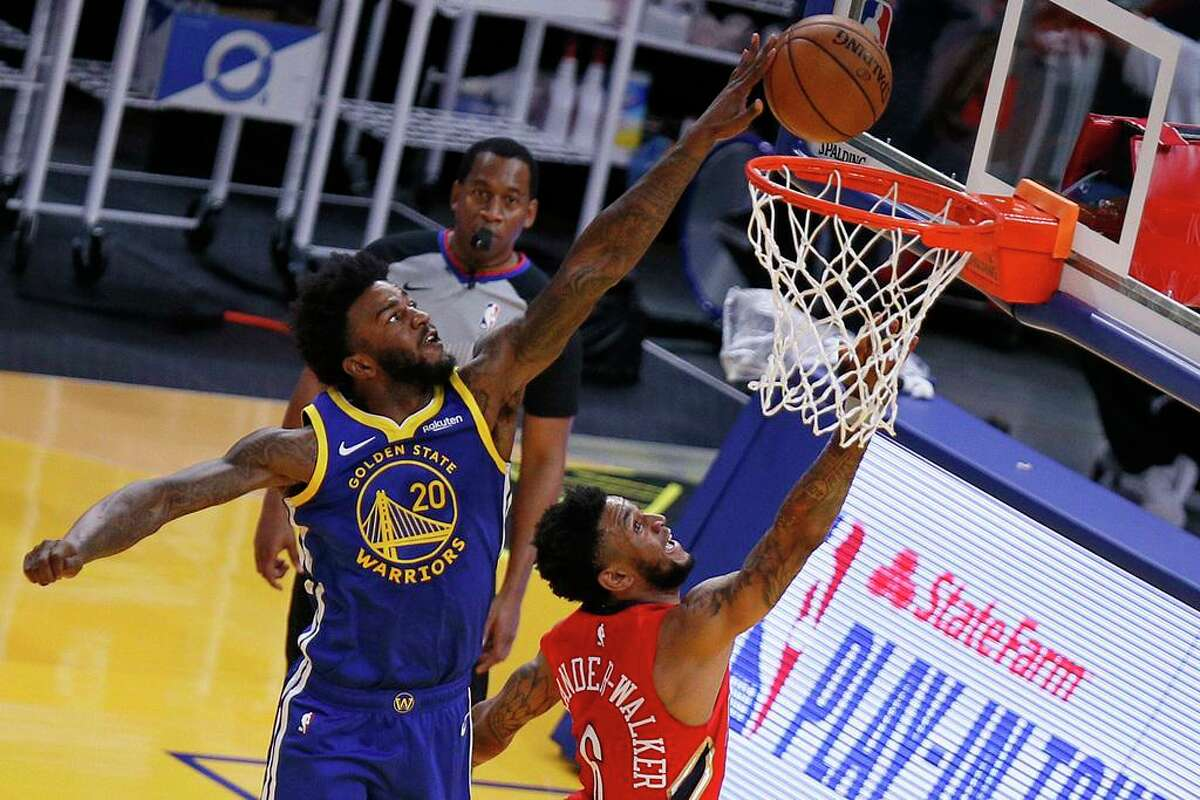 Golden State Warriors Jordan Bell blocks New Orleans Pelicans guard Nickeil Alexander-Walker (6) in the first quarter of an NBA game at Chase Center, Friday, May 14, 2021, in San Francisco, Calif.